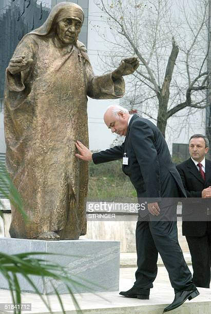Albanian President Alfred Moisiu bows in respect and touches a bronze statue of Mother Teresa of Calcutta, born to Albanian parents in Skopje,...