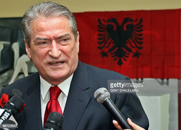 Albanian Prime Minister and Democratic Party leader Sali Berisha speaks to the press after casting his vote in Tirana on June 28 2009 Albanians went...
