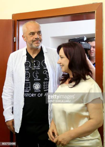 Albanian Prime Minister Edi Rama and his wife Linda Basha arrive to cast their ballots at a polling station in the village of Surrel, near Tirana,...