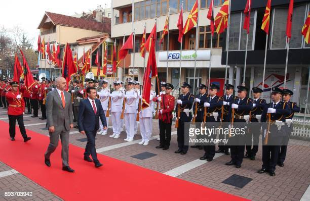 Albanian Prime Minister Edi Rama and Macedonian Prime Minister Zoran Zaev walk past the honour guards during the welcoming ceremony ahead of their...