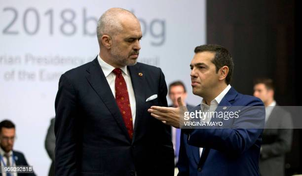 Albanian Prime Minister Edi Rama speaks with Greek Prime Minister Alexis Tsipras during a round table meeting of EU and Western Balkan heads of state...