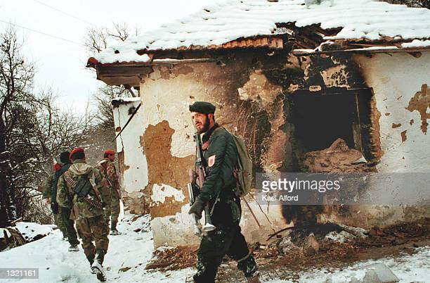 Albanian rebels from the UCPMB walk near a fomer Serb bunker December 21 2000 near the village of Dordjevac 3 km inside the ground safety zone in...