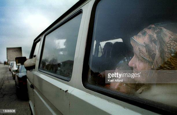 Albanian refugees from the Presevo valley in southern Serbia enter the American KFOR controlled sector of Kosovo at the Mucibaba border crossing...