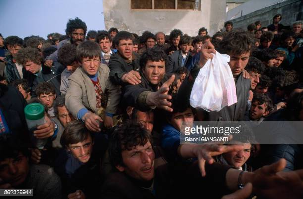 Albanian refugees who fled their country arrive in Brindisi, March 1991, Italy.