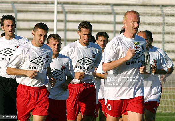 Albanian soccer players run during a training session in Durres on the eve of their match against Greece 03 September 2004 Albania plays Euro 2004...