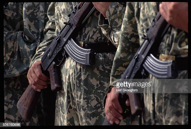 """Albanian soldiers stand in formation with American officers during """"Peaceful Eagle '95,"""" a program in which the American 3rd Infantry helped train..."""