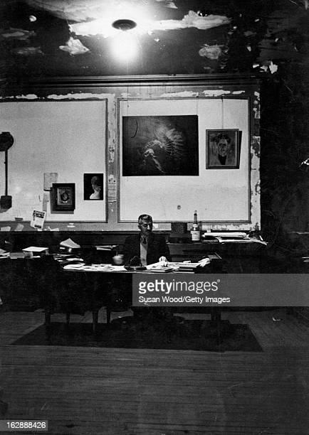 Albanianborn American photographer Gjon Mili sits at a desk in his loft New York New York 1962