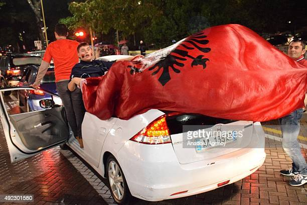 Albanians celebrate in Tirana on October 11 2015 after Albanian National football team qualified for the first time in their history for Euro 2016...