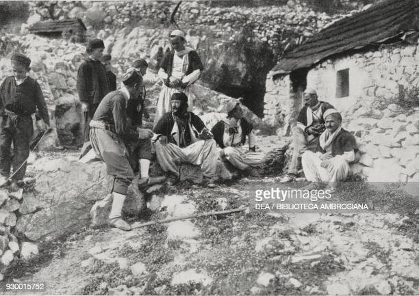 Albanians fleeing from the sites of the massacres and taking refuge in Montenegro First Balkan War photograph by Aldo Molinari from L'Illustrazione...