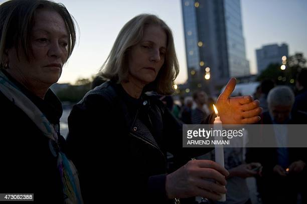 Albanians light candles in Pristina on May 12 to commemorate policemen who were killed after fighting between Macedonian police and an armed group in...