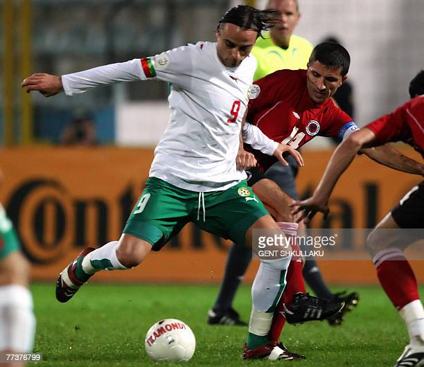 Albania's Altin Lala vies for the ball with Bulgaria's Dimitar Berbatov during their Euro 2008 championship Group G qualifying football match in...