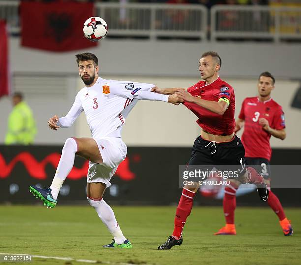 Albania's Ansi Agolli vies with Spain's Gerard Pique during the FIFA World Cup 2018 qualification football match Albania vs Spain at the LoroBorici...
