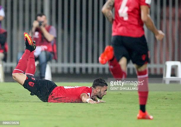 Albania's Armando Sadiku celebrates after scoring a goal during the World Cup 2018 qualifier football match Albania vs Macedonia in Loro Borici...