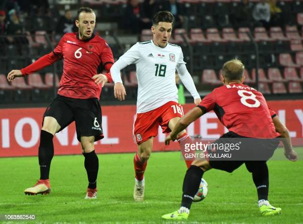 Albania's defender Ardian Ismajli and Migjen Basha vie for the ball with Wales' midfielder Harry Wilson during the friendly football match between...