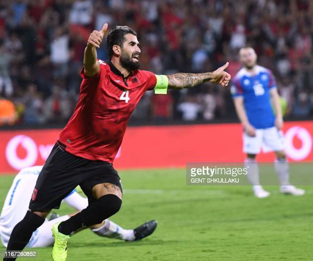 Albania's defender Elseid Hysaj celebrates scoring a goal during the Euro 2020 Group H qualification football match between Albania and Iceland at...