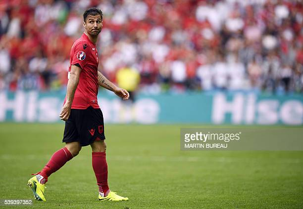 Albania's defender Lorik Cana reacts after being shown the red card during the Euro 2016 group A football match between Albania and Switzerland at...