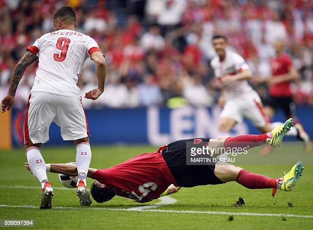 Albania's defender Lorik Cana vies with Switzerland's forward Haris Seferovic during the Euro 2016 group A football match between Albania and...