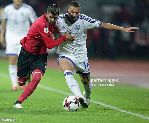 Albania's Elseid Hysaj vies with Israel's Ben Sahar during the 2018 World Cup group G qualifying football match between Albania and Israel in Elbasan...