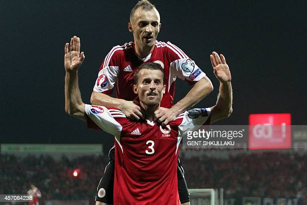 Albania's Ermir Lenjani and Ansi Agolli celebrate after scoring during the Euro 2016 qualifying round football match between Albania and Denmark at...