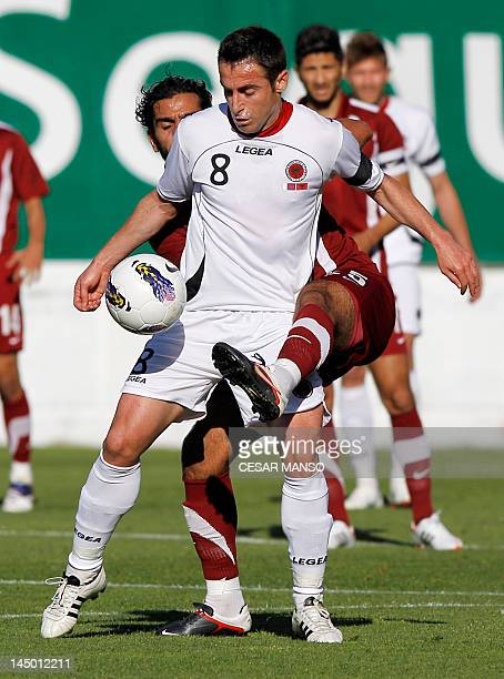 Albania's Ervin Bulku vies for the ball with Qatari Adel Lamy during the friendly football match between Qatar and Albania at Vallecas stadium in...
