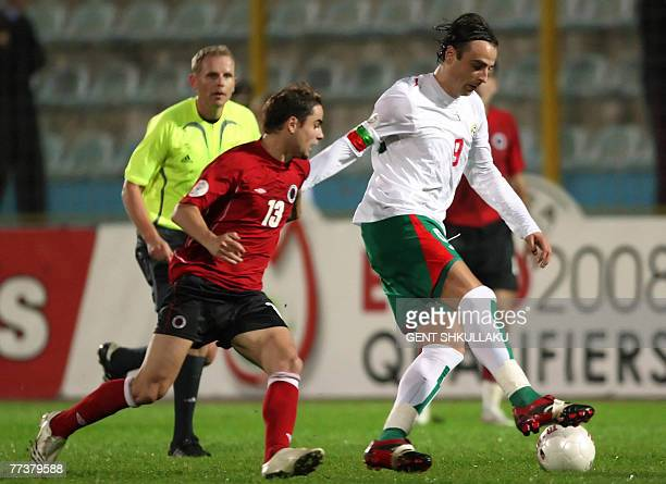 Albania's Ervin Skela vies for the ball with Bulgaria's Dimitar Berbatov during their Euro 2008 championship Group G qualifying football match in...