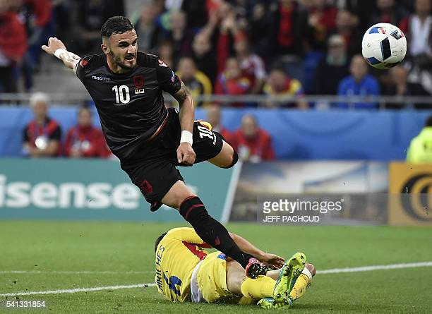 TOPSHOT Albania's forward Armando Sadiku tries to score during the Euro 2016 group A football match between Romania and Albania at the Parc Olympique...
