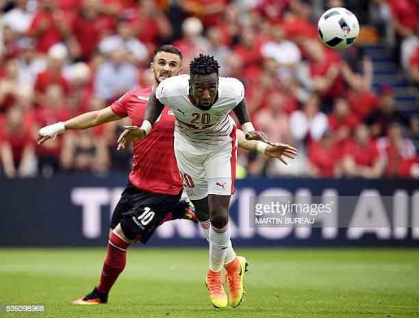 TOPSHOT Albania's forward Armando Sadiku vies with Switzerland's defender Johan Djourou during the Euro 2016 group A football match between Albania...