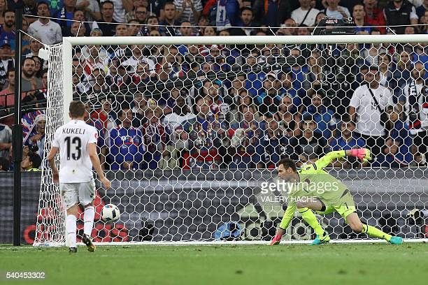 Albania's goalkeeper Etrit Berisha misses the ball during the Euro 2016 group A football match between France and Albania at the Velodrome stadium in...