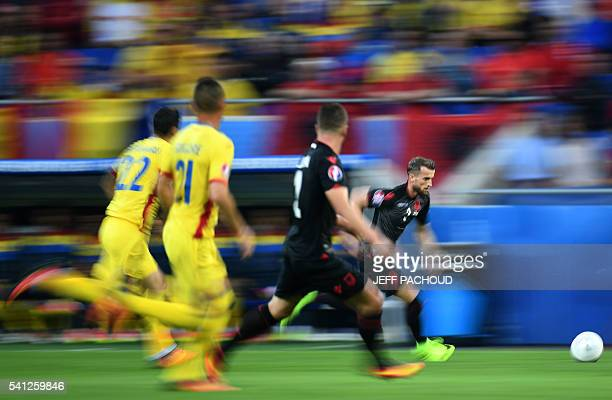 TOPSHOT Albania's midfielder Ermir Lenjani runs for the ball during the Euro 2016 group A football match between Romania and Albania at the Parc...