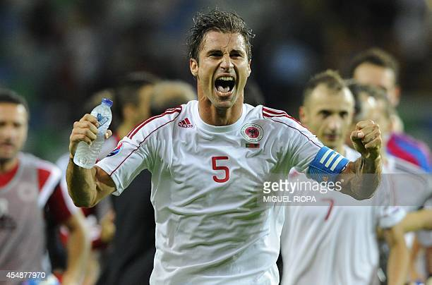 Albania's midfielder Lorik Cana celebrates at the end of the UEFA EURO 2016 Qualifier football match Portugal vs Albania at the Municipal Stadium in...