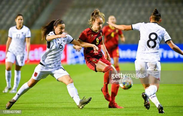 Albania's midfielder Lucie Gjini and Belgium's forward Tessa Wullaert fight for the ball during the 2023 FIFA Women's World Cup qualifying football...