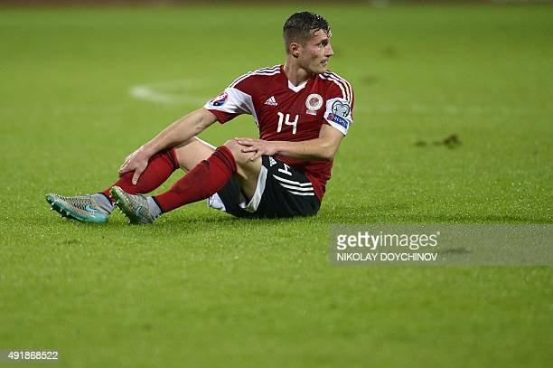 Albania's midfielder Taulant Xhaka looks at Serbian players after Serbia's defender Aleksandar Kolarov scored a goal during the Euro 2016 Group I...