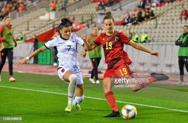 Albania's Mimoza Hamidi and Belgium's Chloe Vande Velde fight for the ball during a soccer game between Belgium's national team the Red Flames and...