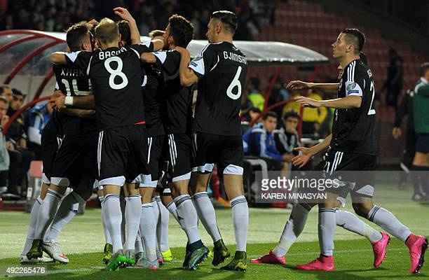 Albania's players celebrate after scoring a goal during the Euro 2016 group I qualifying football match between Armenia and Albania on October 11...