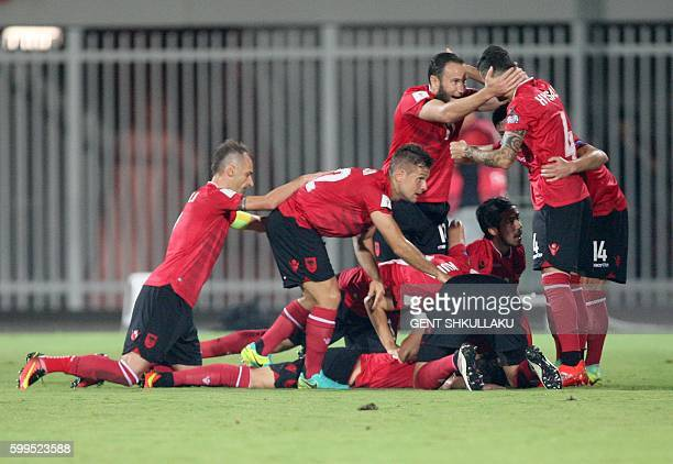 Albania's players celebrate after scoring a goal during the World Cup 2018 qualifier football match Albania vs Macedonia in Loro Borici stadium in...