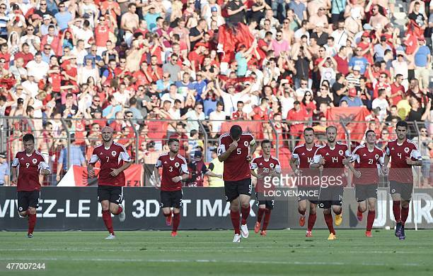 Albania's players celebrate after scoring during a friendly football match Albania vs France on June 13 2015 in Elbasan outside Tirana AFP PHOTO /...