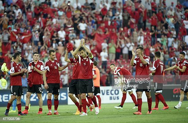 Albania's players celebrate after winning a friendly football match Albania vs France on June 13 2015 in Elbasan outside Tirana AFP PHOTO / LOIC...