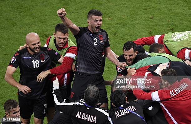 TOPSHOT Albania's players celebrate the opening goal by Albania's forward Armando Sadiku during the Euro 2016 group A football match between Romania...