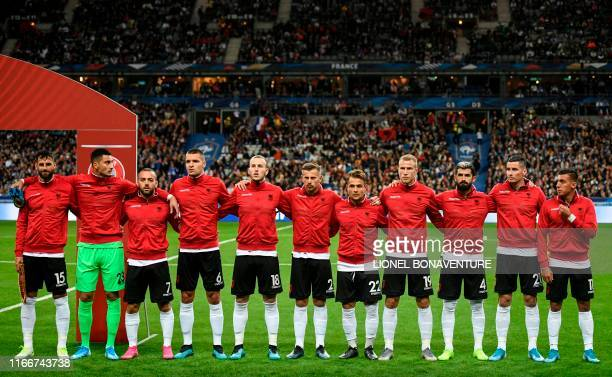 Albania's players stand during the national anthems ceremony before the kick off of the UEFA Euro 2020 qualifying Group H football match between...