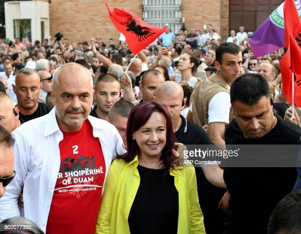 Albania's Prime Minister Edi Rama and wife Linda Basha arrive before a victory rally on June 27, 2017 in Tirana, following June 25 general elections,...