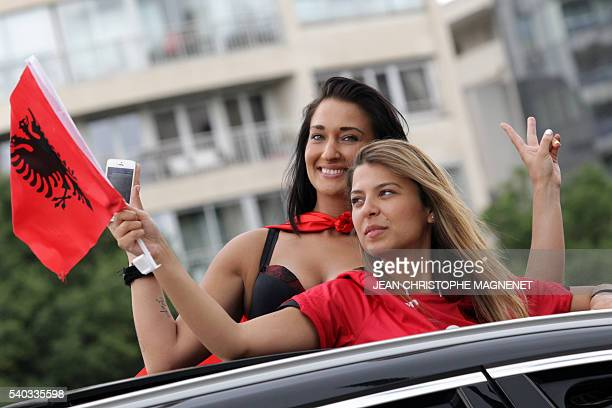 Albania's supporters cheer their team as they arrive on June 15 2016 at the stade Velodrome of Marseille southern France prior to the Euro 2016...
