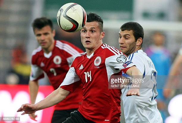 Albania's Taulant Xhaka challenges Armenia's Hovhannes Hambardzumyan during the Euro 2016 group I qualifying football match between Albania and...