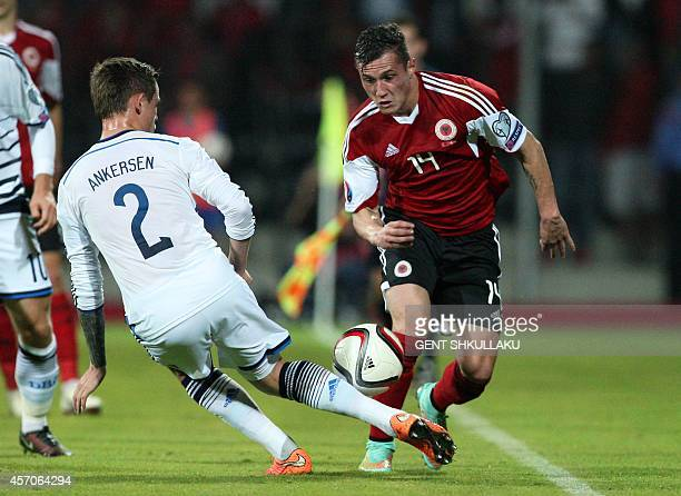 Albania's Taulant Xhaka vies for the ball with Denmark's Peter Ankersen during the Euro 2016 qualifying round football match between Albania and...