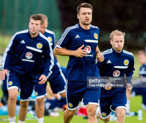 Scotland's Russell Martin warms up