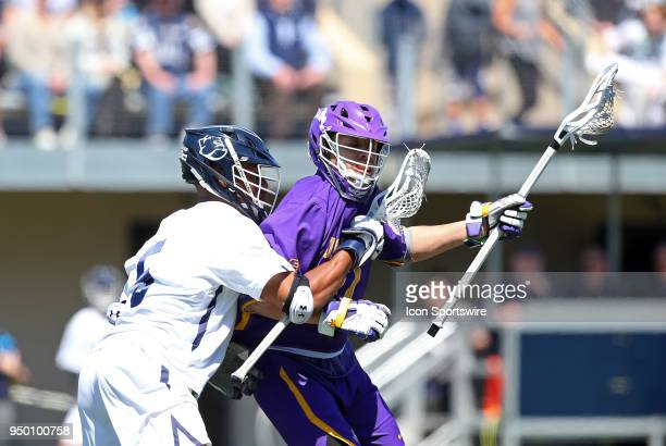 Albany Great Danes attackmen Jakob Patterson and Yale Bulldogs midfielder Tyler Warner in action during a college lacrosse match between Albany Great...