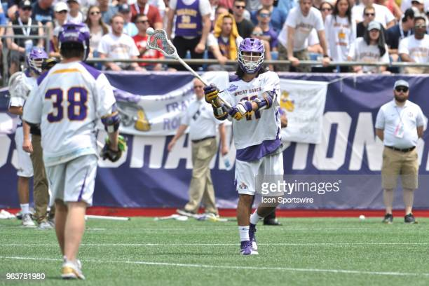 Albany Justin Reh classes the ball to Albany Sean Eccles . During the Albany Great Danes game against the Yale Bulldogs at Gillette Stadium on May...