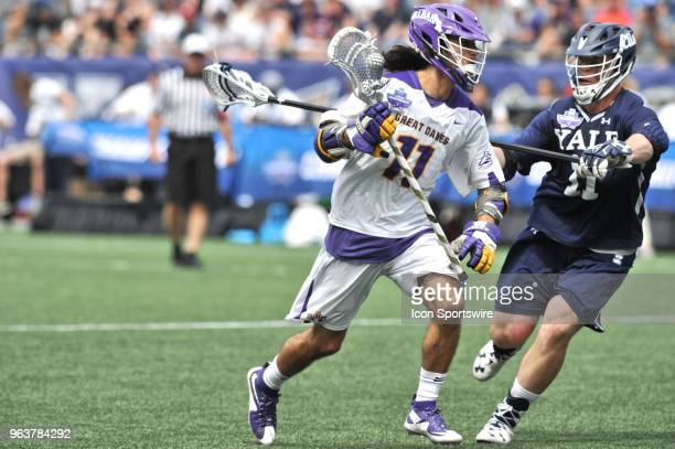 Albany Justin Reh tries to get past Yale Christopher Keating . During the Albany Great Danes game against the Yale Bulldogs at Gillette Stadium on...