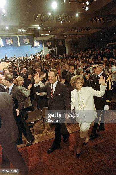 Governor Mario Cuomo and his wife Matilda respond 1/1 to applause as they make their way to the podium at his inauguration in Albany Cuomo was sworn...