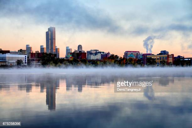 albany new york skyline reflection along a misty hudson river - hudson river stock pictures, royalty-free photos & images