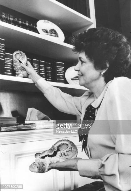 Matilda Cuomo wife of Mario Cuomo hides a cuccioli a traditional Easter bread at the Governor's mansion in Albany NY on March 26 1985
